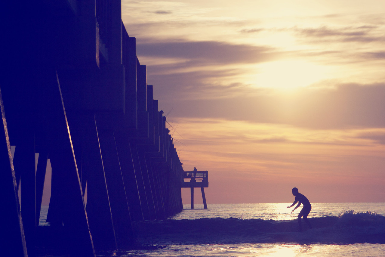 Early morning surfing at Jacksonville Beach Pier.